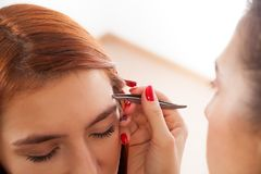 Master on the eyebrows working royalty free stock photo