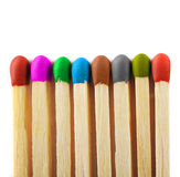 Close up of matches of different colors. Close up of matches isolated on a white background with colors red, purple, green, blue, brown, gray, dark green Royalty Free Stock Image