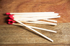 Close-up of matches. Some matches on wooden background stock photos