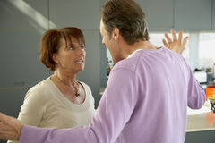 Close-up of a mature couple arguing. Close-up of a mature couple looking at each other Stock Photos