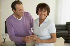 Close-up of a mature couple holding a gift.  royalty free stock photography