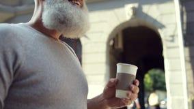 Close up of mature man drinking take away coffee stock video