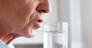 Close up of mature man drinking water. Close up mature man drinking water on a glass stock video footage