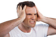 Close up of mature man with head in hand clenching teeth Royalty Free Stock Images