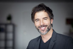Close Up Of A Mature Man Smiling. At The Camera stock images