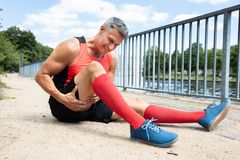 Man With Sprain Thigh Muscle. Close-up Of A Mature Man With Sprain Thigh Muscle royalty free stock photography