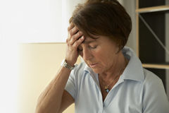 Close-up of a mature woman with a headache Royalty Free Stock Photo
