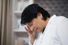 Close up of mature woman suffering with headache Royalty Free Stock Images