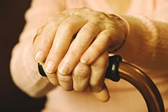 Close up of mature womans hands. Health care giving, nursing home. Parental love of grandmother. Old age related diseases. Elderly woman in nursing home royalty free stock photography