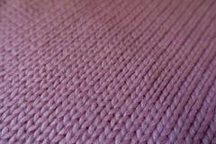 Close up of mauve handmade stockinet fabric Stock Photography