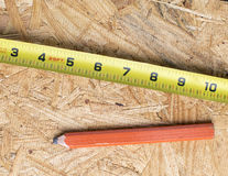 Close up measuring tape and pencil Royalty Free Stock Photo