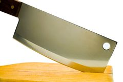 Close-up of meat cleaver with cutting board Royalty Free Stock Photography