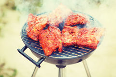 Close up of meat on grill outdoors Stock Image