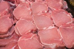 Close up of meat in a supermarket. Raw meat at butcher shop. Pork Stock Images