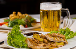 Close up Meat and Vegetable Dish with Beer Royalty Free Stock Images