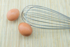 Close up of meat whisk and eggs Royalty Free Stock Photography