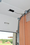 Close up on mechanical garage door opener mechanism. Mechanical garage door opener mechanism Royalty Free Stock Photo
