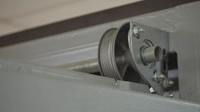 Close up on mechanical garage door opener mechanism.  stock video