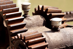 Close-up mechanical gear with a large toothed wheel. Of Floodgate valve royalty free stock image