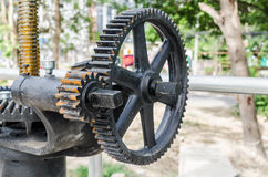 Close-up mechanical gear with a large toothed wheel of Floodgate Royalty Free Stock Image