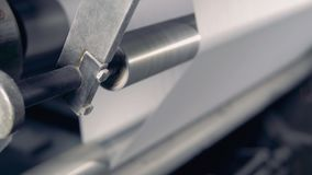 Close up of mechanical shafts moving a paper web on a high speed. stock video footage