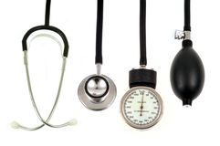 Stethoscope and sphygmomanometer on a white background stock photo