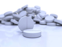 Close-up medical pills. On blue surface stock photo