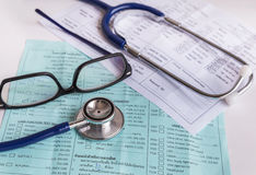 Close up medical stethoscope with glasses on blood chart prescription paper Stock Photo