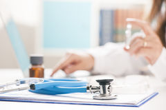 Close-up of a medical worker typing on laptop.  royalty free stock images