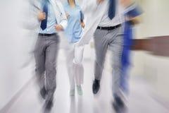 Close up of medics or doctors running at hospital Stock Photo