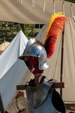 Close up of Medieval Knight`s Silver Helmet and Red and Yellow Feather.  Royalty Free Stock Images