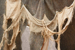 Close-up of medieval rags waving on the wall Stock Images