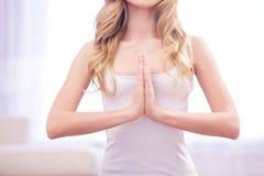 Close up of meditating woman Stock Photography