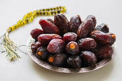 Close up of medjoul - dried dates or kurma. In a vintage plate Royalty Free Stock Images