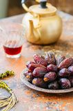 Close up of medjoul - dried dates or kurma. In a vintage plate Royalty Free Stock Photography