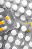 Close-up meds in gray packagings on a shiny background. Prescripted medication. Drugs, antibiotics, painkillers in white tablets. Macro picture of medical Stock Photo