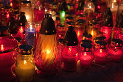 Close-up of memorial candles on the All Saints Day. Memorial candles shining at the cemetery on the All Saints Day Day  (November 1st Stock Images