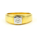 Close up of Men's golden wedding ring with diamond isolated on w Royalty Free Stock Images