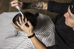 Close up of men`s hairstyling and haircutting in a barber shop . stock images