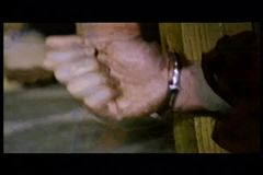 Close-up of men's hands in handcuffs trying to escape stock video footage