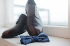Close-up of mens shoes and a bow tie. royalty free stock photos
