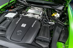 Close up of Mercedes-Benz engine AMG GTR 2018 V8 Bi-turbo exterior details. Powerful handcrafted engine. royalty free stock image