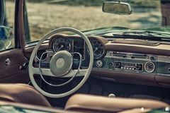 Close up on Mercedes vintage car steering wheel and cockpit Stock Photography