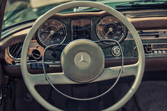 Close up on Mercedes vintage car steering wheel and kockpit Royalty Free Stock Images