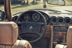 Close up on Mercedes vintage car steering wheel and kockpit Stock Photos