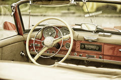 Close up on Mercedes vintage car steering wheel and kockpit Royalty Free Stock Photo