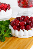 Close up meringue cake with cream and cranberries. Royalty Free Stock Photography