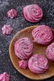 Close-up meringues cookies on wooden plate Stock Image