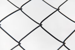 Close up of mesh fence over gray sky Royalty Free Stock Image