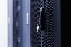 Free Close Up Meshed Door With Key In Lock. Button In Server Room. Blur Background Of Racks Rows With Network And Hardware In The Data Royalty Free Stock Images - 144517539
